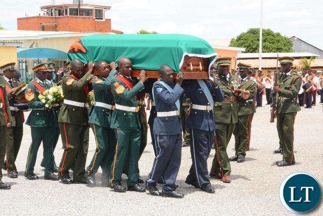 Zambia Army officer carrying the coffin for the late former Deputy speaker of Parliament Mukondo Lungu at Lusaka City airport before departure to Lundazi for burial