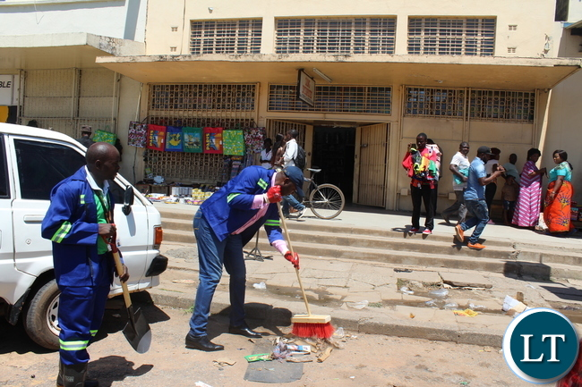 Copperbelt Minister Bowman Lusambo cleans Chisokone Avenue in Ndola
