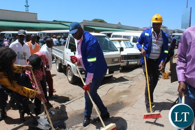 Copperbelt Minister takes part in a street cleaning exercise along Ndola's Chisokone Avenue