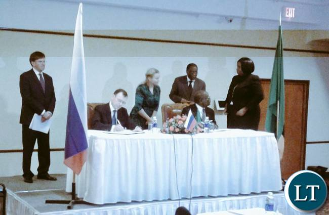 Zambian Govt officials signing documents with Russia's Rosatom for development of nucear technology in Zambia