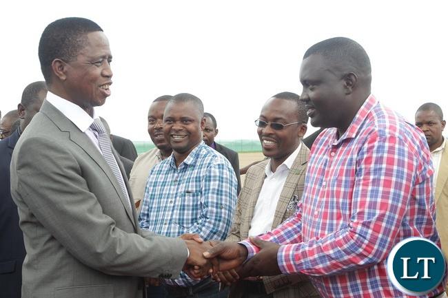 PRESIDENT Edgar Lungu greets Lusaka Province Youth Chairman Kennedy Kamba at Kenneth Kaunda International Airport.