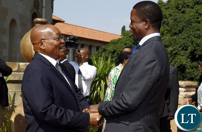 PRESIDENT Edgar Chagwa Lungu being welcomed by his South African counterpart Jacob Zuma at Union Buildings in Pretoria,South Africa on Thursday,December 8,2016. (Picture by Salim Henry/State House)