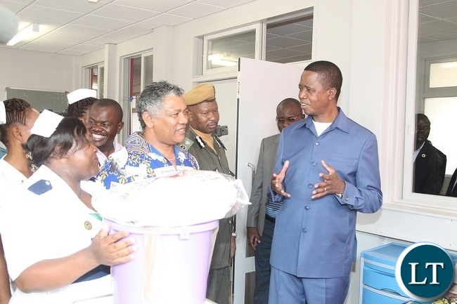 PRESIDENT Edgar Chagwa Lungu confers with Minister of Justice, Given Lubinda when he presented Christmas gifts at Chilenje Hospital