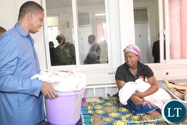 PRESIDENT Edgar Chagwa Lungu presents a Christmas gift to Ruth Mwamba at Chilenje Hospital