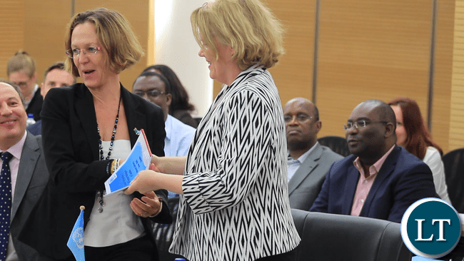 UNHCR Representative, Ms Laura Lo Castro, hands-over the Local Integration National Advisory Group Co-chair role to the UNDP Resident Representative, who is also UN Resident Co-ordnator in Zambia, Ms Janet Rogan