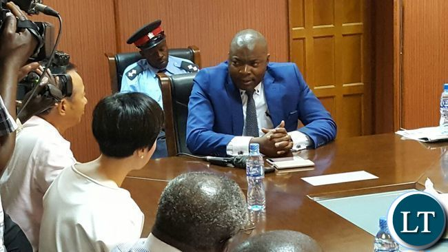 Copperbelt Minister Bowman Lusambo stresses a point to a Chinese mine official at LCM