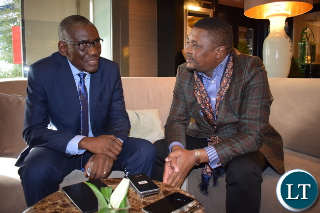 Tourism and Arts Minister Charles Banda (left) talking to Zimbabwe´s Tourism and Hospitality Industry Minister Walter Mzembi at Melia Castilla Hotel in Madrid, Spain. The two are representing their countries at the various high-level meetings with the UNWTO Secretariat and the Spanish government.-Picture by: SAKABILO KALEMBWE