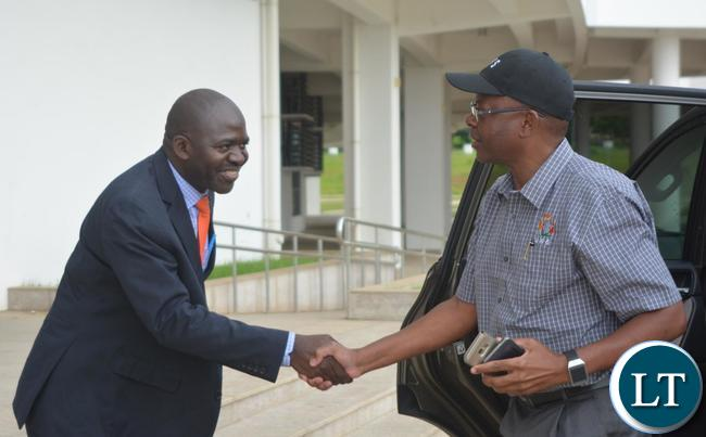 Minister of Energy Mathew Nkhuwa(r) being welcomed by Ministry of Housing and Infrastructure Development Structural Engineer Francis Mundanya(l) at Heroes Stadium