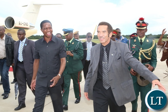 President Lungu and his Botswana counterpart Dr. Ian Khama having a light moment shortly after his arrival at Kasane airport for a two day working visit
