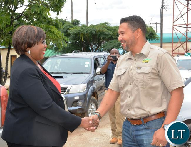Minister of Agriculture Dora Silaya(l) being welcomed by Grain Association of Zambia Chairperson George Liacopoulos(l) during the tour of the Grain Storage Solution