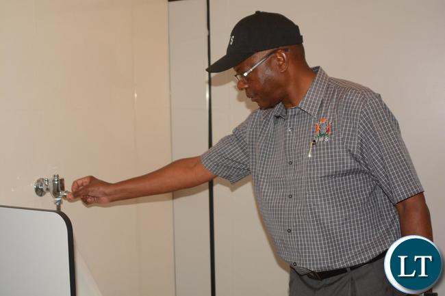 Minister of Works and Supply Mathew Nkhuwa checking the tap at Heroes Stadium as he toured the development of the works