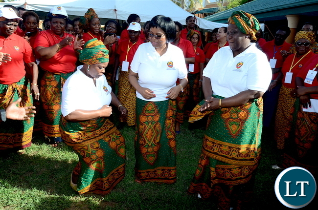 First Lady Esther Lungu and Mozambique First Lady  Isaura Nyusi join women in dancing  during the closing ceremony of the just ended Conference on ending child marriage and early pregnancies in Pemba City, Mozambique on  Sunday,February 26,2017 -Picture by THOMAS NSAMA/STATE