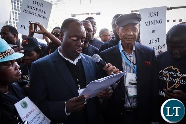 Father Aidan Msafiri of Tanzania Episcopal Conference reads the Alternative Mining Indaba's final declaration.