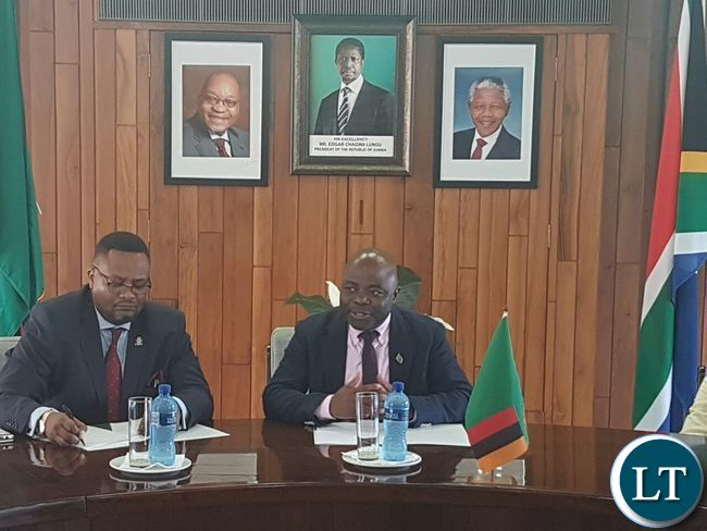 Home Affairs Stephen Kampyongo with High Commissioner Emmanuel Mwamba