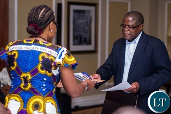 Rev Matale presenting the declaration to Mines Minister Chris Yaluma