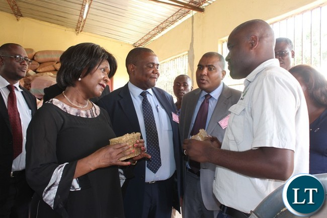 COMMUNITY Market for Conservation (COMACO) Manager, Smith Kapeya and Commerce Minister, Margaret Mwanakatwe confer during the tour of the peanut butter processing plant in Chipata on Thursday. PICTURE BY STEPHEN MUKOBEKO/ZANIS