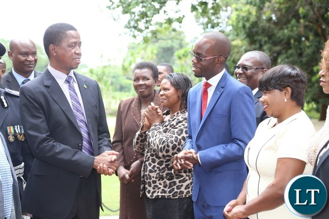 President Edgar Lungu confers with newly appointed Copperbelt Province Permanent Secretary Elias Kamanga after being Sworn in at State House