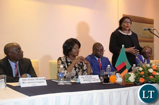 AGRICULTURE Minister, Dora Siliya, speaking at the first Eastern Province Symposium on development at Protea Hotel in Chipata on Thursday. On her right are Eastern Province Minister, Makebi Zulu, Commerce Minister, Margaret Mwanakatwe and Luapula Province Minister, Nixon Chilangwa. PICTURE BY STEPHEN MUKOBEKO/ZANIS