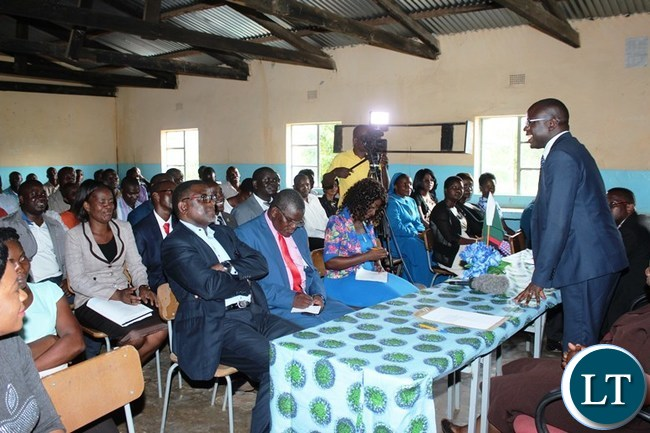 EASTERN Province Minister, Makebi Zulu, addresses Vubwi District civil servants at Vubwi Day Secondary School. The Minister was on his familiarization tour of the district where he also inspected developmental projects under construction. PICTURE BY STEPHEN MUKOBEKO/ZANIS