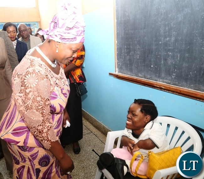 First Lady Esther Lungu(l) chats with a 23 year old Memory Daka a Student at Zambia Institute of Special Education yesterday,3-3-2017, Picture by Ennie Kishiki/Zanis.