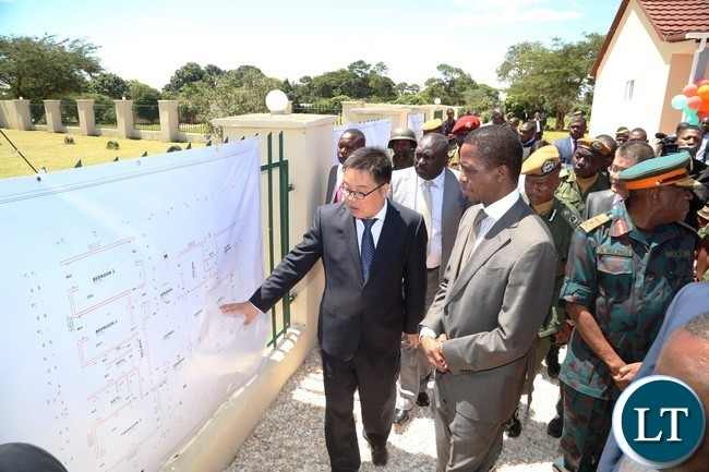 Shandong Dejian Group General Manager Huang Meng shows President Edgar Lungu maps of the Houses during the Launch of the Construction of Zambia National Service (ZNS) Housing Units in Chamba Valley yesterday 30-03-2017 Picture by ROYD SIBAJENE/ZANIS