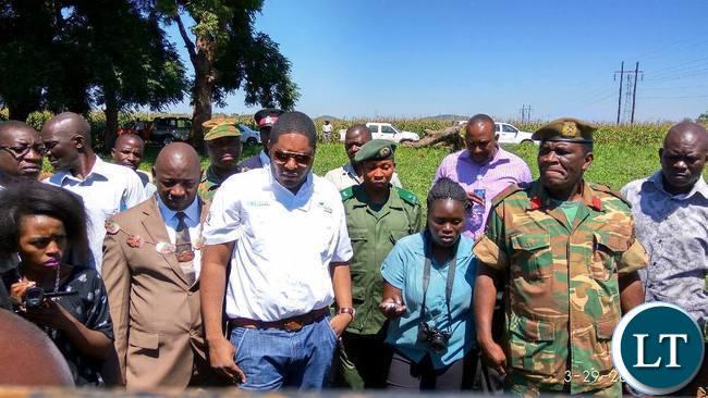 CHIPATA Mayor Sinoya Mwale and Eastern Province Deputy Permanent Secretary Patrick Mwanawasa listening to agronomist Mulundu Mwila during annual field day at Msekera in Chipata on Wednesday