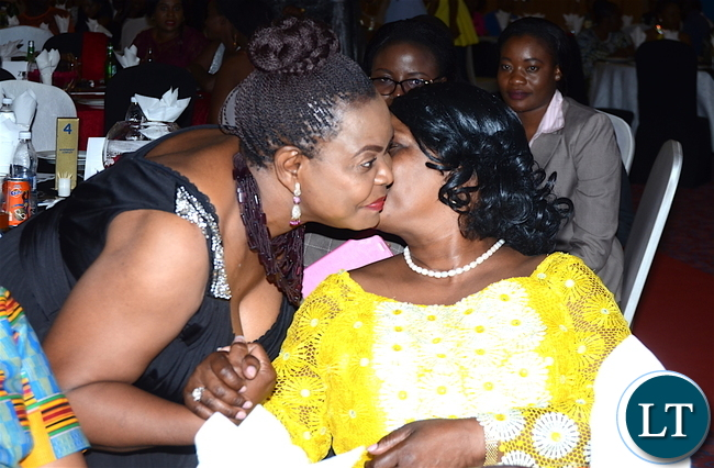 First Lady Esther Lungu being hugged by former first Lady Maureen Mwanawasa during the Afro Multi Media Productions Women of the Year Awards giving Ceremony to mark the International Women's Day Celebrations at Government Complex in Lusaka on Tuesday, March 7,2017 -Picture by THOMAS NSAMA