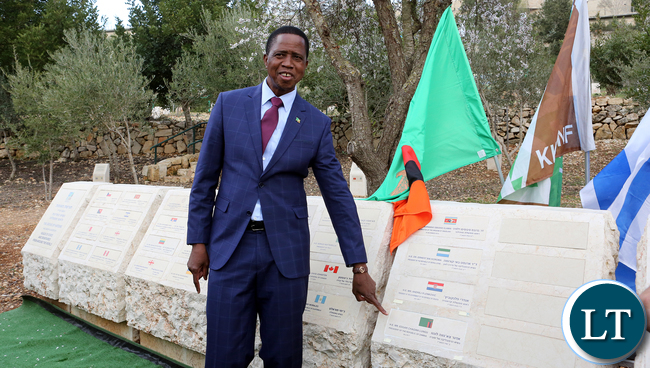 resident Edgar Chagwa Lungu Plants a Tree at The Grove of the Nation in the Jerusalem Forest on Tuesday 28-02-2017