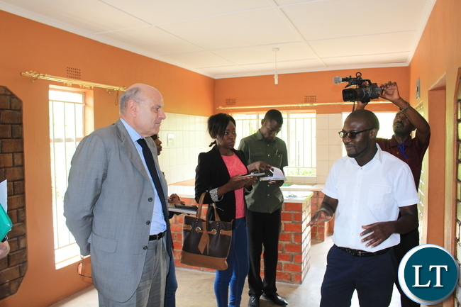 The French Minister of State for Development and Francophonie, Hon. Jean-Marie LE GUEN listens to Mwenya Nsakilwa during the demo house tour