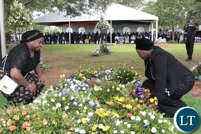FORMER, First Lady, Maureen Mwanawasa(left) and Christine Sata laying  wreaths at Late Regina Chiluba's grave in Lusaka