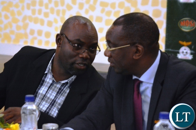 Sports Minister, Moses Mawere(left) confers with Football Association of Zambia Presiden, Andrew Kamanga during the FAZ AGM  In Lusaka