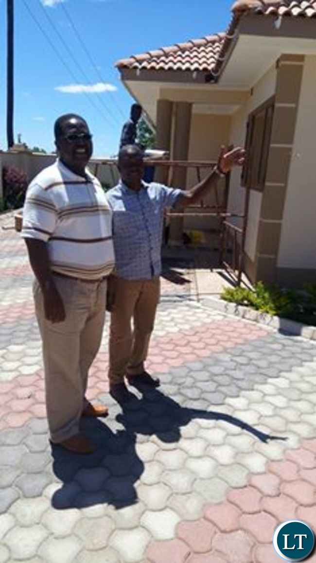 Chengo with Bishop Imakando showing off the house