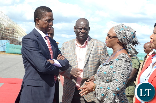 President Edgar Lungu (L) with PF deputy Secretary General Mumbi Phiri as Party Secretary General Davies Mwila (C) looks on at Kenneth Kaunda International Airport shortly before departure for Livingstone on Thursday, April 20,2017-Picture by THOMAS NSAMA