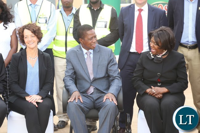 President Edgar Lungu confers with Commerce Minister Magaret Mwanakatwe while Zambia Breweries Country Director Mrs. Annabelle Degroot looks on during the tour and commissioning of the malting plant in Lusaka South Multi-facility Zone