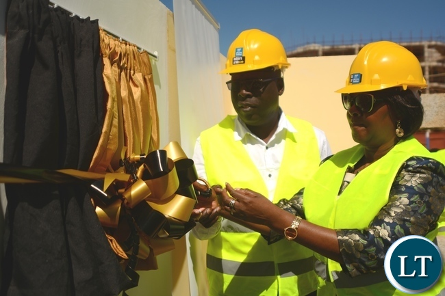 Minister of Commerce,Trade and Industry Margaret Mwanakatwe and Public Service Pension Fund Board Chairman Moses Banda cuts the ribbon during the Alick Nkhata Mall Ground Breaking Ceremony in Lusaka
