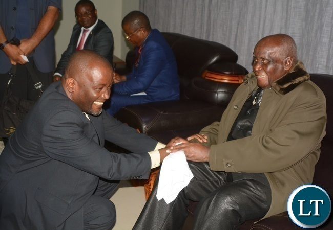 Minister of Water and Sanitation Loyd Kaziya(l) wishing First Republican President Kenneth Kaunda(r) a Happy 93rd Birthday during Zambia Association of Musician KK's Birthday Bash in Chongwe last night