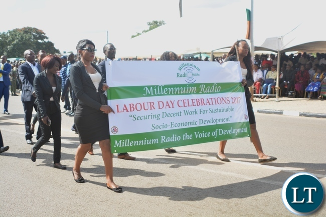 Millennium Radio Staffs matching during the Labour Day Celebration in Lusaka yesterday,01052017.Picture by Ennie Kishiki/Zanis.