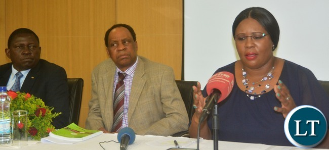 Minister of Agriculture Dora Silaya(r)with Permanent Secretary for Ministry of Agriculture Julius Shawa and Indaba Agricultural Policy Research Institute Chance Kabaghe during the press briefing on the uplifting of Maize burn in Zambia at Government Complex in Lusaka