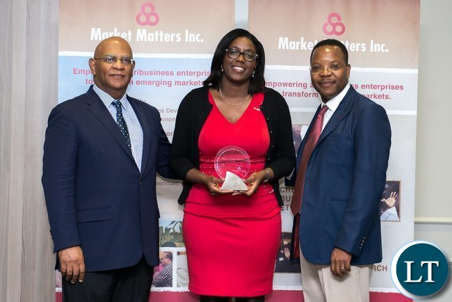 2017 African Agribusiness Entrepreneur of the Year Monica Musonda displays poses with her award