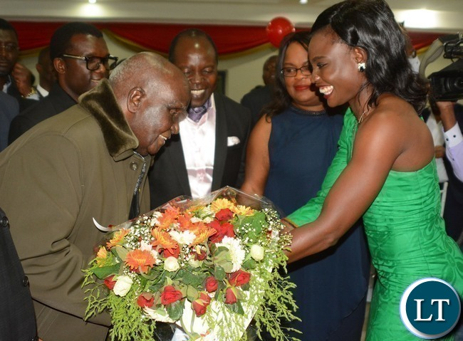 First Republican President Kenneth Kaunda(l) blesses Boxer Catherine Phiri(r) after she presented a bouquet during Zambia Association of Musician KK's Birthday Bash in Chongwe