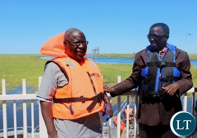 Western Province Permanent Secretary Mwangala Liomba (r) shares a light moment with his counterpart Zimbabwean Energy Permanent Secretary Patson Mbiri (l) during the tour of Matongo Platform, a Hydrometric Station on the Barotse Flood Plain in Mongu