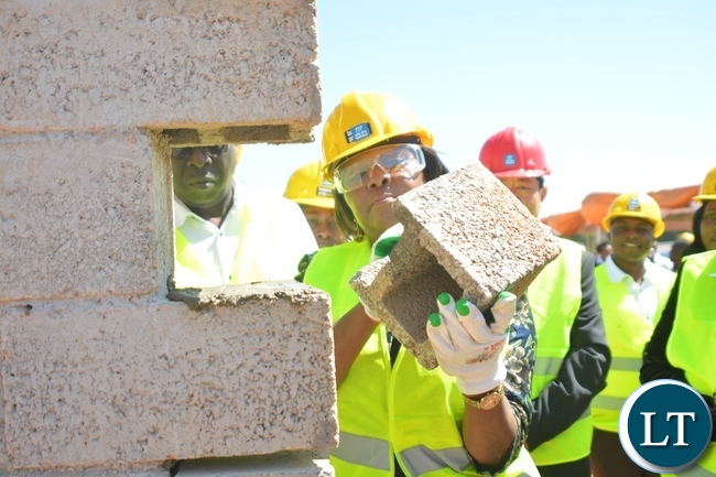 Minister of Commerce,Trade and Industry Margaret Mwanakatwe helping in building Alick Nkhata Mall during Ground Breaking Ceremony in Lusaka
