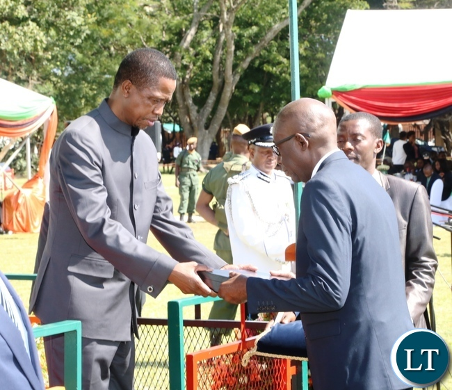 President Edgar Lungu gives a medal to Kawumbe Nkanza on behalf of his late Father William Nkanza during the Africa Freedom Day at State House