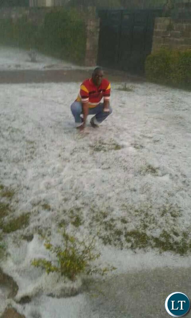 A man in Lusaka posing in ice