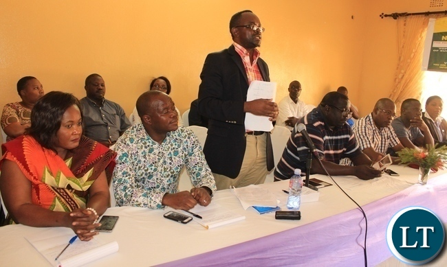 Parliamentary Committee on Health, Community Development and Social Services Chairperson, Dr. Jonas Chanda, addresses Masaiti residents during a public hearing in the district