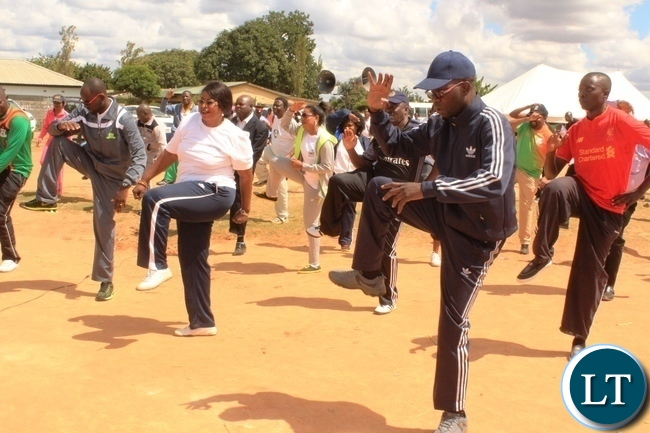 Copperbelt Province Permanent Secretary, Elias Kamanga leads heads of government departments in doing aerobics after he launched the National Health Week at Wusakile Ground in Kitwe on Monday. Left is Mufulira District Commissioner, Hilda Kabwesha and Kitwe District Commissioner, Binwell Mpundu