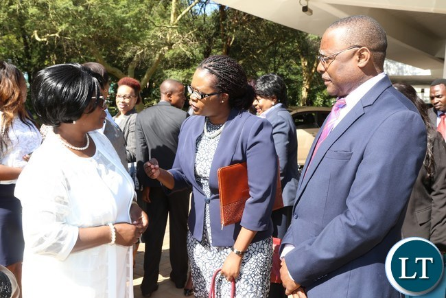 First Lady Esther Lungu talks to Law Association of Zambia Executive Director Edward Sakala (right) while LAZ President Linda Kasonde (c) listens during the National Legal Aid Clinic for Woman breakfast meeting at Pamodzi Hote