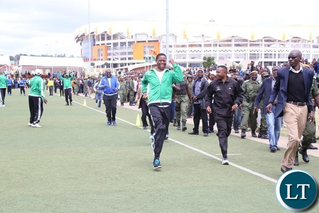 President Edgar Lungu takes part in the 100metres race during the official launch of the 2017 National Health Week at the Olympic Youth Development Centre