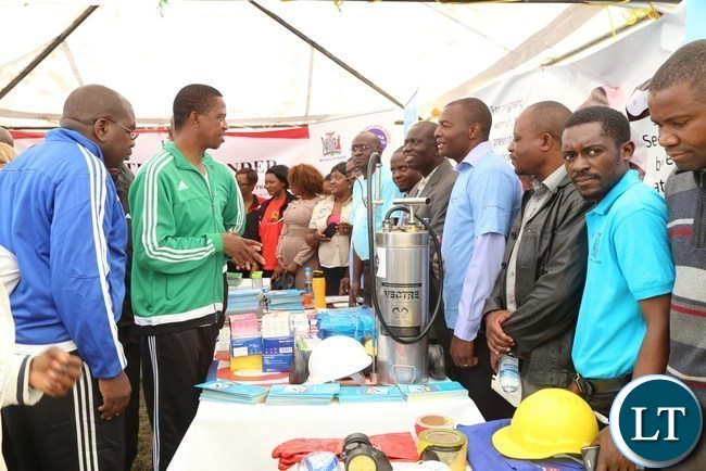 President Edgar Lungu flanked by Health Minister Dr.Chitalu Chilufya tours the selected stands during the official launch of the 2017 National Health Week at the Olympic Youth Development Centre