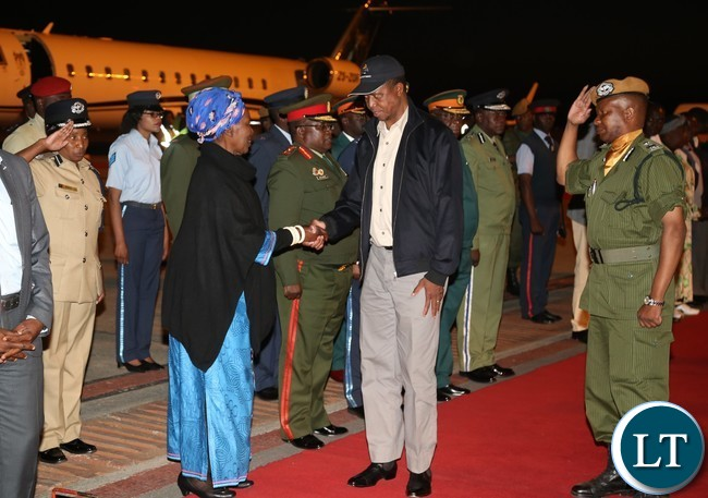 Vice President Inonge Wina and Service Chiefs welcomes President Edgar Lungu at Kenneth Kaunda International Airport (KKIA) shortly after his arrives form Ndola for a two working visit yesterday 25-06-2017. Picture by ROYD SIBAJENE/ZANIS